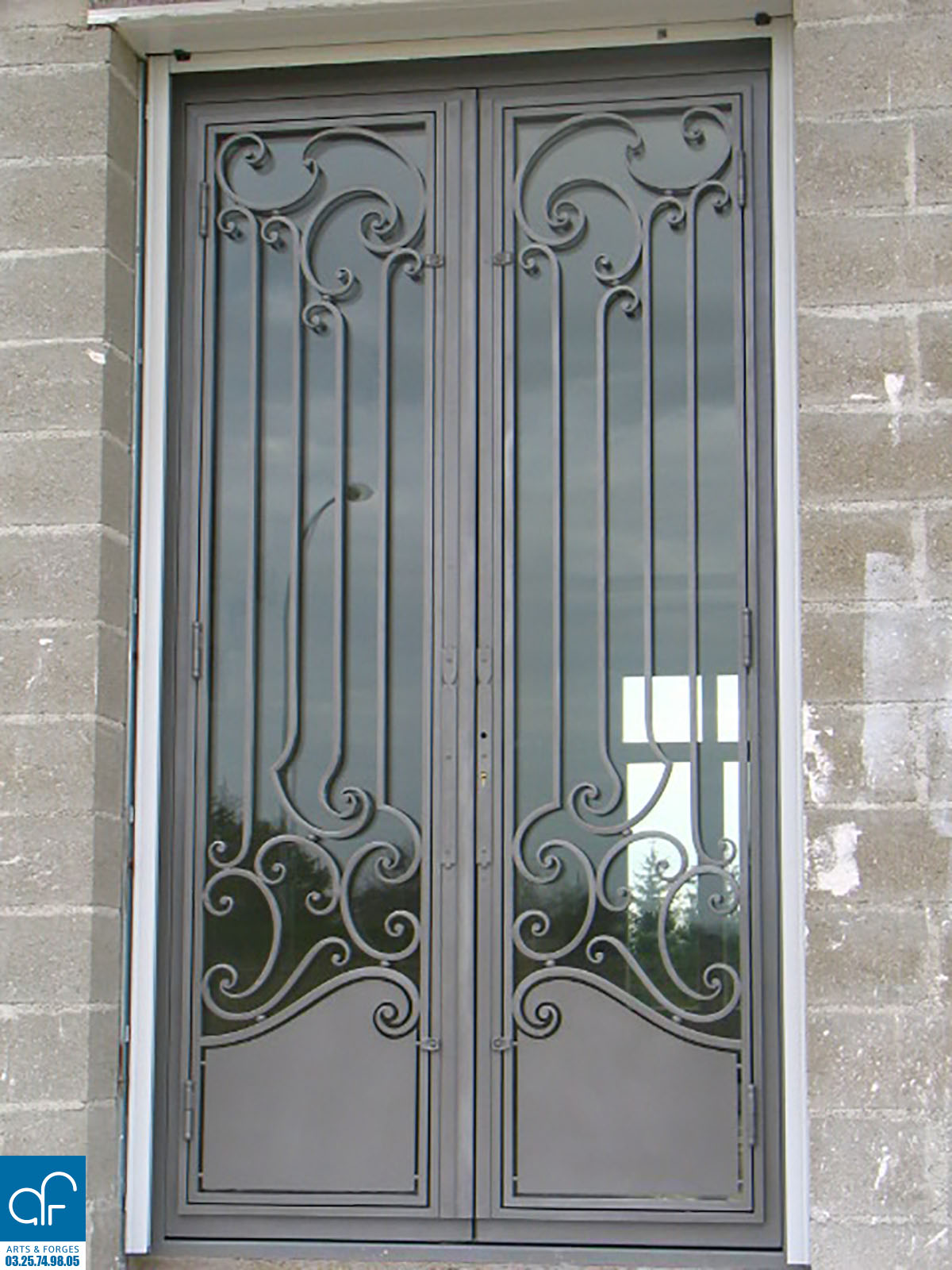 Portes et fen tres arts et forges for Porte metallique de service